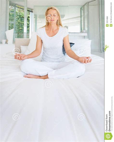 lotus position in bed lotus position in bed royalty free stock image mature