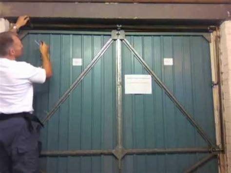 Garage Door Tension Henderson Merlin Garage Door How To Add Tension To The Mov