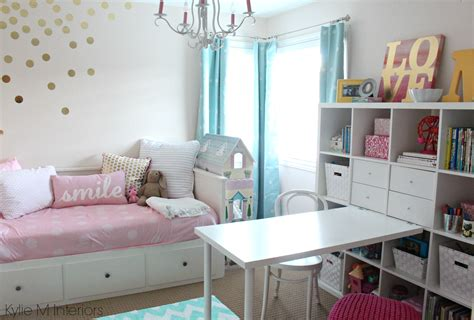 girls bedroom  benjamin moore pink bliss  chandelier ikea hemnes bed  kallax bookshelf