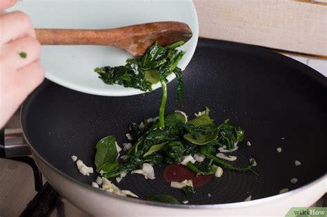 cocinar con espinaca 3 formas de cocinar espinaca beb 233 wikihow