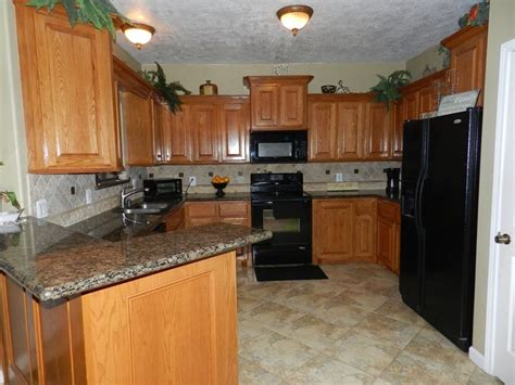kitchens with black appliances and oak cabinets kitchens with oak cabinets with black appliances and