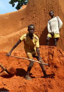 digging for gold children work in harsh conditions paid slave labour behind blood diamonds jewellery dug from
