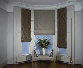 Silk curtains for bay windows on a wrought iron bay pole