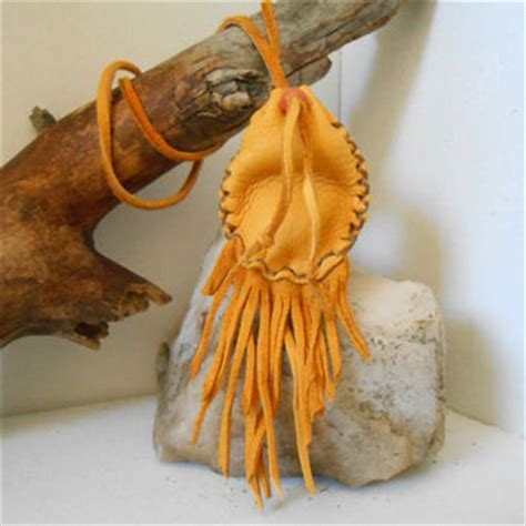 Paprika Kuning Golden Small Pouch best handmade leather fringe bags products on wanelo