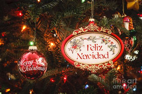 decorated tree with feliz navidad and merry christmas