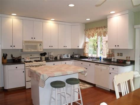 paint veneer kitchen cabinets paint quot euro style quot laminate cabinets and add hardware