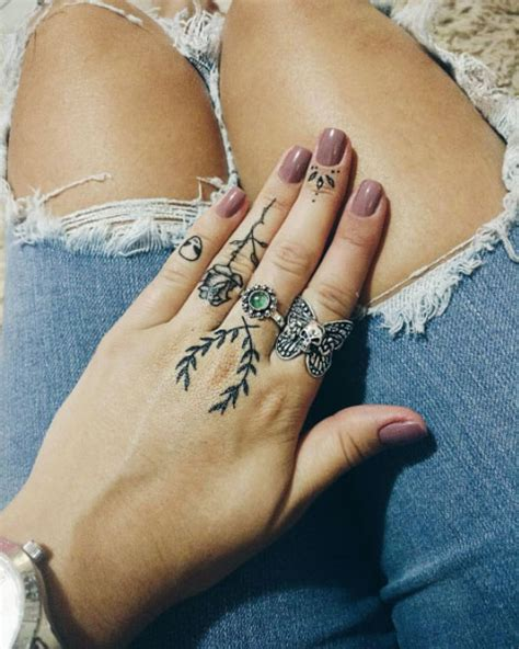 50 eye catching finger tattoos that women just can t say
