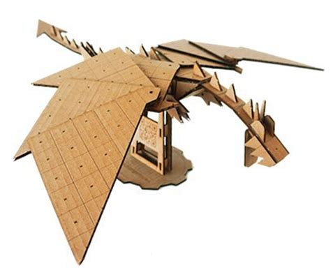 new release grid kit go media 183 creativity at work make jointed hot glue gunned cardboard toys boing boing