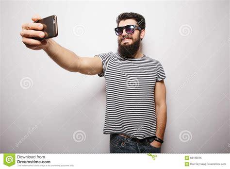 happiest hipster smiling happy hipster man in sun glasses with beard taking