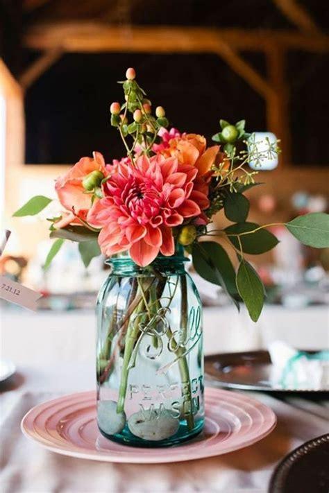 mason jars filled   colourful flowers  wedding