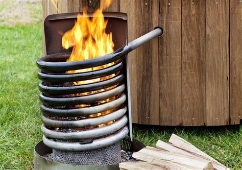 wood heated bathtub wood fired hot tub dutchtub heats organically 3 jpg