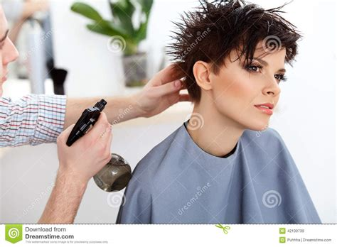 hairdresser photos of pixie haircuts hairdresser doing hairstyle brunette with short hair in