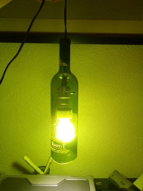 making a l out of a wine bottle make a hanging light out of a wine bottle