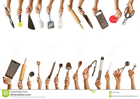 Many Hands Holding Different Kitchen Tools Stock Photo