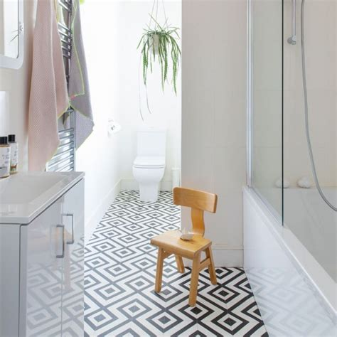 geometric black and white floor tiles modern monochrome bathroom with geometric vinyl floor
