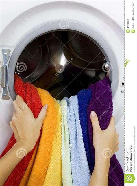 color clothes wash taking color clothes from washing machine stock
