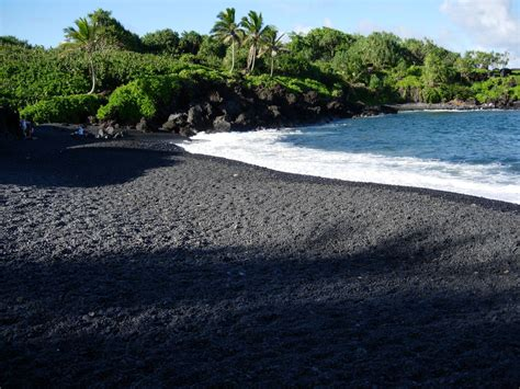 beach with black sand 5 reasons why black sand beaches rock