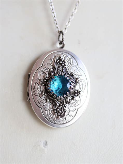 jewelry lockets locket necklace blue topaz locket roses silver oval