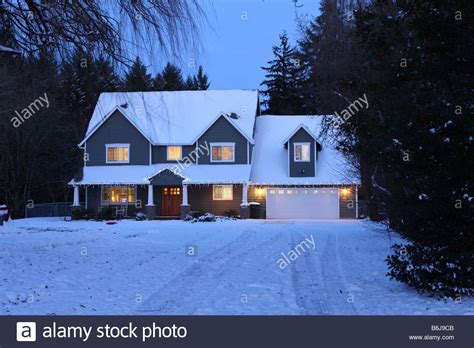 winter house winter home house at with lights on and snow stock