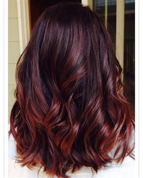 tri color highlights on shoulder length hair stylist burgundy hair with dark red purple and brown highlights