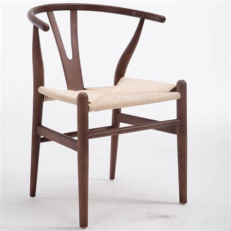 chair in beech wood for restaurant and dining room idfdesign modern hans wegner wishbone dining chair beech wood walnut