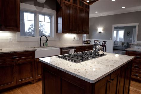 island with stove top and black gas stove top on white cambria quartz granite