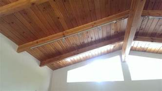 Ceiling Roof insulation insulating a post and beam construction roof