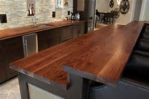 custom wooden kitchen island with raised bar top in walnut