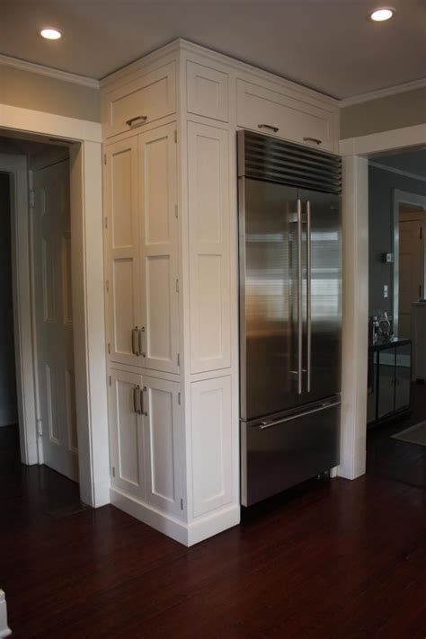how to level kitchen cabinet doors doors beside built in fridge side cabinet fridge in corner white kitchen cabinets wood floor