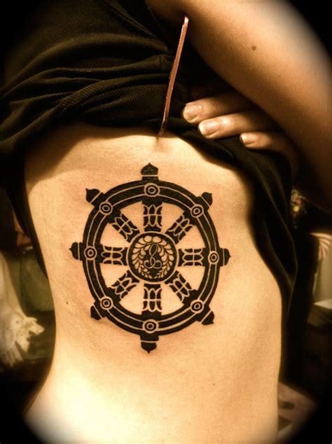 dharma tattoo dharma wheel side tattoomagz