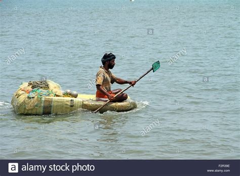 poor boat poor fisherman rowing thermocol boat stock photo royalty
