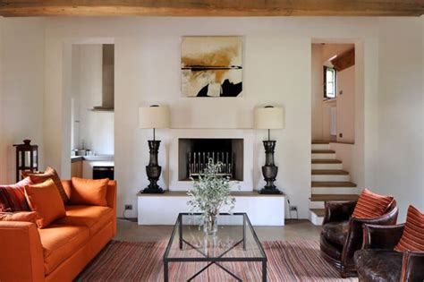 orange and white living room transition of a fortified italian farmhouse