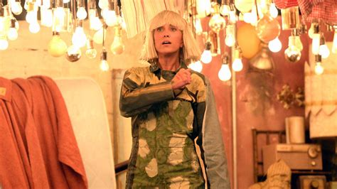 kristen wiig join sia for chandelier performance