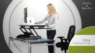 desks that raise varidesk plus adjustable riser