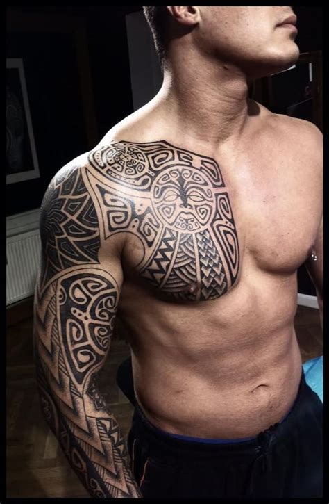 tribal chest and arm tattoos viking on sleeve and chest by walrus madsen