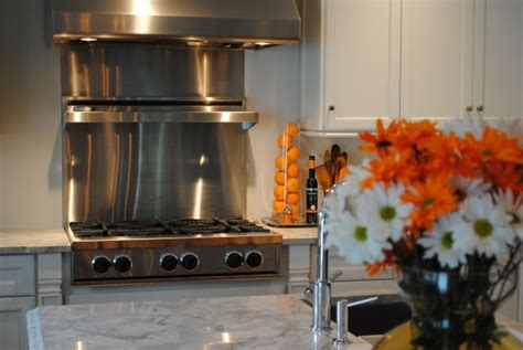 stainless steel backsplash with shelf pin by blaha on kitchen ideas