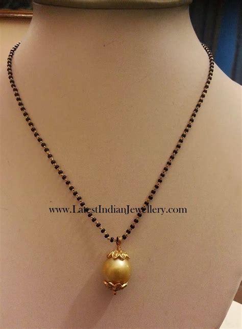 fancy light weight black beads gold mangalsutra designs