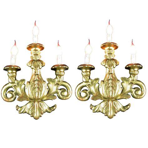 applique antiche coppia di appliques antiche in legno dorato a tre fiamme