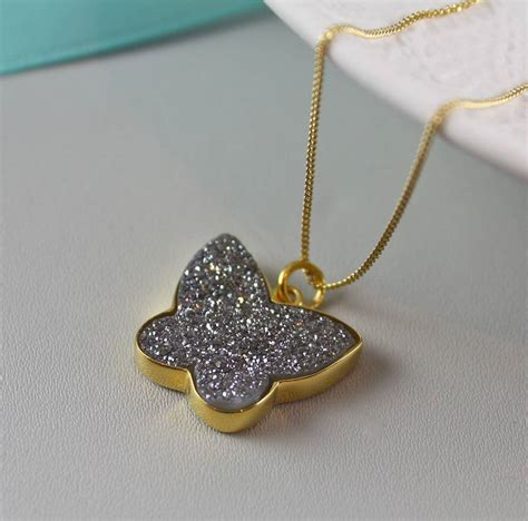 Sweet Gray Shells Small Butterfly Necklace Gold butterfly pendant in gold with druzy by claudette worters notonthehighstreet
