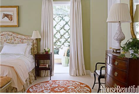 sage green accent wall behind the all white bed with 21 rosemary lane recreating a dream bedroom room from