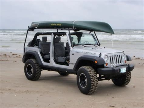 jeep with surfboard kongo cage as surfboard rack jk top jeepforum