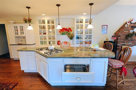 Galley kitchen & family room remodeled into a large