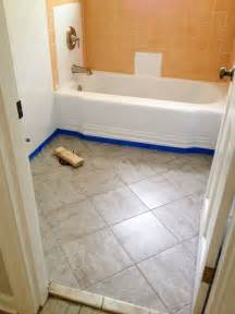 remodelaholic bathroom redo grouted peel and stick