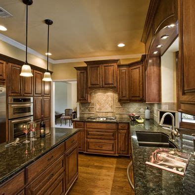 uba tuba granite with oak cabinets 16 best images about cabinets with uba tuba granite on