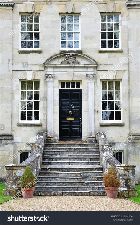 english house music exterior and garden of a beautiful georgian era english house stock photo 155162234