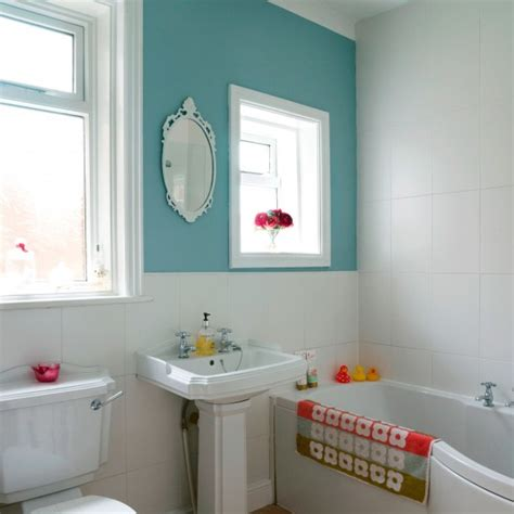 compact bathroom  colourful feature wall small