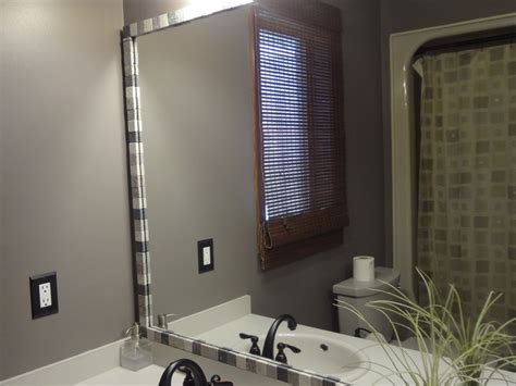 add a decorative touch to mirrors by adding tiles around