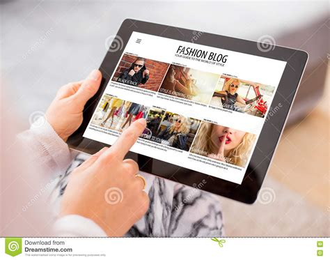 reading on tablet reading fashion on tablet stock photo image