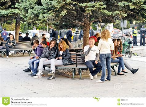 people sitting on a park bench people sitting on a park bench in bitola editorial photo image 40861091