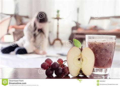 Detox Diet Foggy Blurry healthy smoothie with apple and grapes stock photo